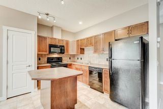Photo 7: 100 28 Heritage Drive: Cochrane Row/Townhouse for sale : MLS®# A1076913