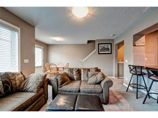 Photo 7: 113 WINDSTONE Mews SW: Airdrie House for sale : MLS®# C4016126