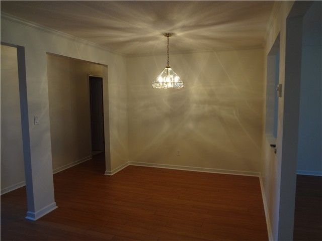 Dining Room: New laminate flooring in this 14' long dining room. Bring on the quests.