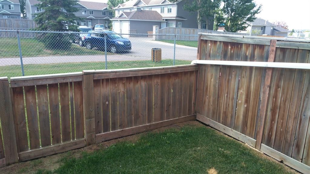 Rear Yard, sunny South. Fenced, backs on larger greenspace.