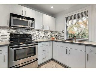 Photo 2: 1847 W 14TH Avenue in Vancouver: Kitsilano 1/2 Duplex for sale (Vancouver West)  : MLS®# V1035652