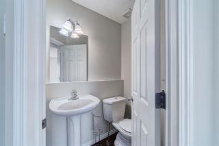 Photo 5: 4 136 Bow Ridge Drive: Cochrane Row/Townhouse for sale : MLS®# A1116097