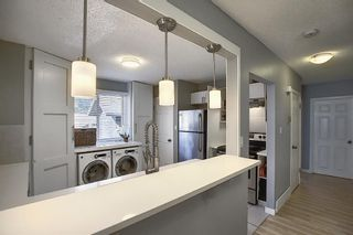 Photo 10: 412 33 Avenue NE in Calgary: Winston Heights/Mountview Semi Detached for sale : MLS®# A1068062