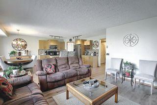 Photo 15: 140 Douglas Ridge Green SE in Calgary: Douglasdale/Glen Detached for sale : MLS®# A1114470