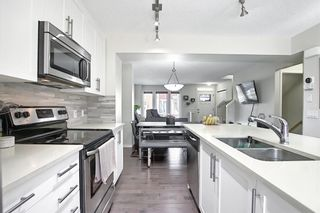 Photo 15: 203 Auburn Meadows Walk SE in Calgary: Auburn Bay Row/Townhouse for sale : MLS®# A1103923