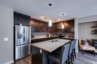 Photo 2: 203 Evanston Manor NW in Calgary: Evanston Row/Townhouse for sale : MLS®# A1149522