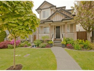 """Photo 1: 5767 148A Street in Surrey: Sullivan Station House for sale in """"Sawyers Walk at Panorama Village"""" : MLS®# F1310562"""