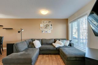 Photo 6: 113 ASPEN HILLS Drive SW in Calgary: Aspen Woods Row/Townhouse for sale : MLS®# A1057562
