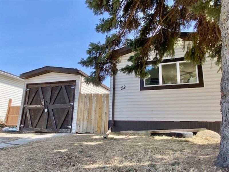 FEATURED LISTING: 52 Big Hill Way Southeast Airdrie