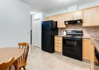 Photo 16: 218 950 ARBOUR LAKE Road NW in Calgary: Arbour Lake Row/Townhouse for sale : MLS®# A1136377