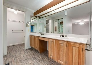 Photo 30: 24 WOOD Crescent SW in Calgary: Woodlands Row/Townhouse for sale : MLS®# A1154480