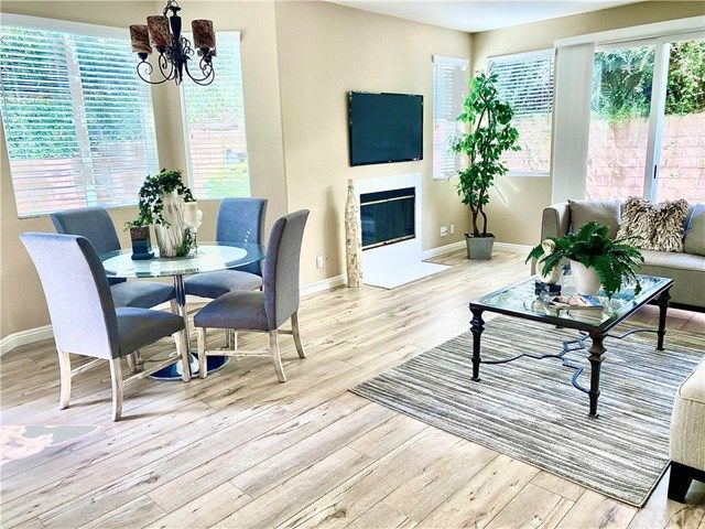 New Plank flooring, cozy fireplace in living room