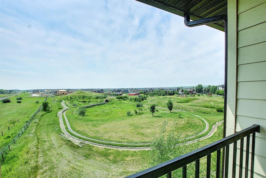 Main Photo: 6413 304 Mackenzie Way SW: Airdrie Apartment for sale : MLS®# A1128019