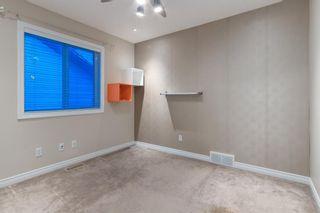 Photo 15: 560 Cougar Ridge Drive SW in Calgary: Cougar Ridge Detached for sale : MLS®# A1072318