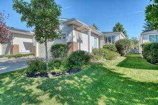 Photo 3: 55 CEDUNA Park SW in Calgary: Cedarbrae Duplex for sale : MLS®# A1015320