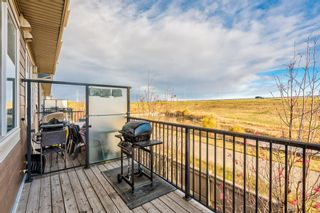 Photo 7: 504 Panatella Walk NW in Calgary: Panorama Hills Row/Townhouse for sale : MLS®# A1153133