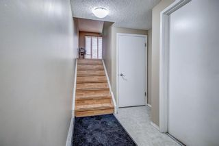 Photo 3: 1309 Ranchlands Road NW in Calgary: Ranchlands Row/Townhouse for sale : MLS®# A1060522