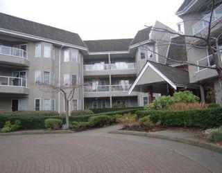 "Photo 1: 305 2020 CEDAR VILLAGE Crescent in North Vancouver: Lynn Valley Condo for sale in ""Kirkstone Gardens"" : MLS®# V803443"