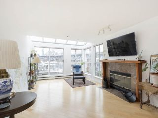 """Photo 8: 406 1551 MARINER Walk in Vancouver: False Creek Condo for sale in """"LAGOONS"""" (Vancouver West)  : MLS®# R2548149"""