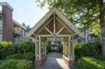 """Main Photo: 302 843 22ND Street in West Vancouver: Dundarave Condo for sale in """"TUDOR GARDENS"""" : MLS®# R2569496"""