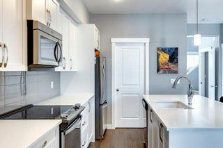 Photo 10: 971 Nolan Hill Boulevard NW in Calgary: Nolan Hill Row/Townhouse for sale : MLS®# A1114155