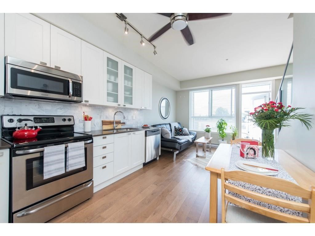 Ample living area with entertaining space on main floor deck off the living room.