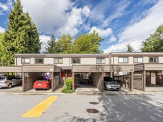 """Photo 1: 3953 PARKWAY Drive in Vancouver: Quilchena Townhouse for sale in """"ARBUTUS VILLAGE"""" (Vancouver West)  : MLS®# R2591201"""