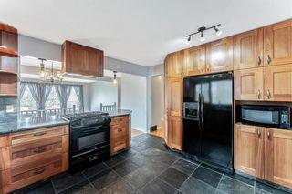 Photo 11: 8011 Silver Springs Road NW in Calgary: Silver Springs Detached for sale : MLS®# A1106791
