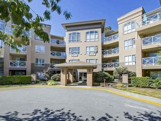 Photo 1: 414-2551 Parkview Lane in Port Coquitlam: Central Pt Coquitlam Condo for sale : MLS®# R2529934