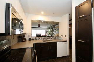 "Photo 1: 201 1369 56 Street in Delta: Cliff Drive Condo for sale in ""WINDSOR WOODS"" (Tsawwassen)  : MLS®# R2455271"