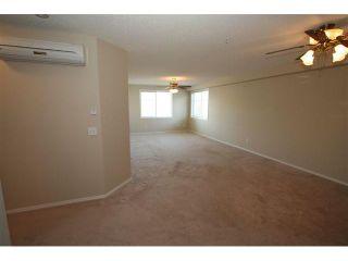 Photo 5: 2212 200 COMMUNITY Way: Okotoks Condo for sale : MLS®# C3434173