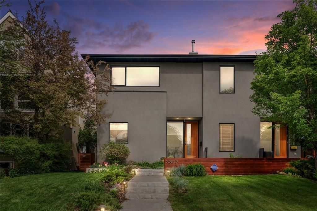 Designed by Architect John Brown, this modern family home sits atop the ridge on tree lined 1A Street in Parkhill.