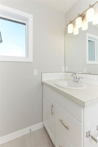 Photo 13: 1310 WALDEN Drive SE in Calgary: Walden Semi Detached for sale : MLS®# C4194452