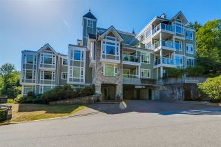 "Photo 1: 404 3001 TERRAVISTA Place in Port Moody: Port Moody Centre Condo for sale in ""NAKISKA"" : MLS®# R2096996"