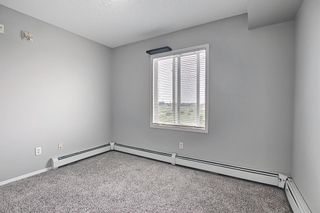 Photo 28: 6413 304 Mackenzie Way SW: Airdrie Apartment for sale : MLS®# A1128019