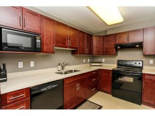 "Photo 6: 110 3075 PRIMROSE Lane in Coquitlam: North Coquitlam Condo for sale in ""LAKESIDE TERRACE"" : MLS®# V1117875"