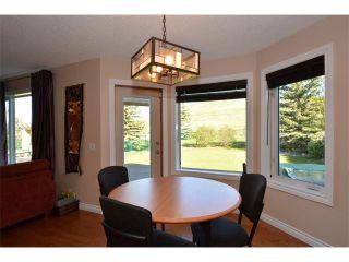 Photo 11: 148 GLENEAGLES Close: Cochrane House for sale : MLS®# C4010996