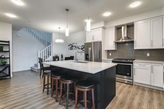 Photo 11: 618 148 Avenue NW in Calgary: Livingston Detached for sale : MLS®# A1149681