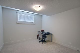 Photo 37: 165 Burma Star Road SW in Calgary: Currie Barracks Detached for sale : MLS®# A1127399