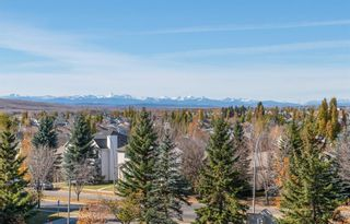 Photo 2: 404 7239 Sierra Morena Boulevard SW in Calgary: Signal Hill Apartment for sale : MLS®# A1153307
