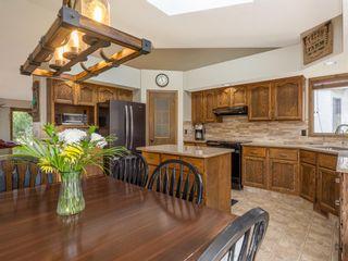 Photo 8: 107 Hawktree Bay NW in Calgary: Hawkwood Detached for sale : MLS®# A1113635