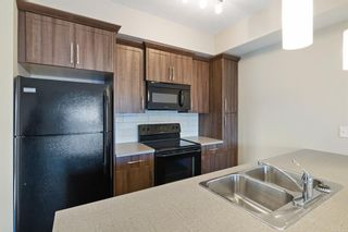 Photo 7: 9308 101 Sunset Drive: Cochrane Apartment for sale : MLS®# A1141889