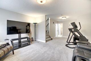Photo 22: 374 Quarry Park Boulevard SE in Calgary: Douglasdale/Glen Row/Townhouse for sale : MLS®# A1063797