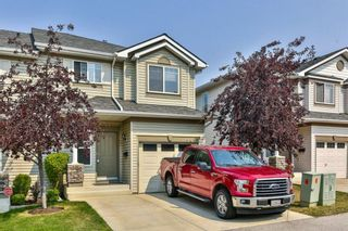 Photo 2: 93 Rocky Vista Circle NW in Calgary: Rocky Ridge Row/Townhouse for sale : MLS®# A1071802