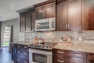 Photo 11: 215 Sunset Point: Cochrane Row/Townhouse for sale : MLS®# A1148057