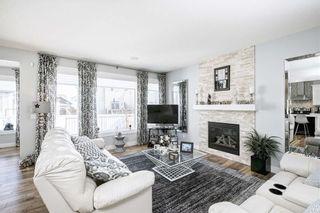 Photo 3: 811 New Brighton Drive SE in Calgary: New Brighton Detached for sale : MLS®# C4300093