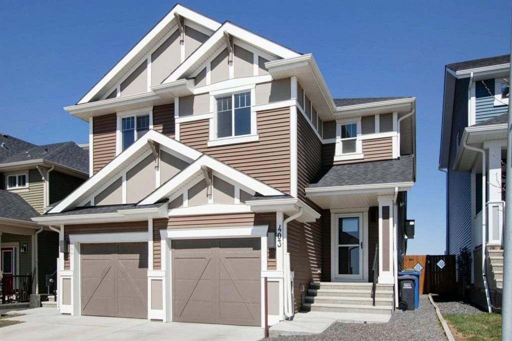 Main Photo: 403 Sunrise View: Cochrane Semi Detached for sale : MLS®# A1098056