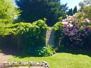 """Photo 4: 4852 QUEENSLAND Road in Vancouver: University VW House for sale in """"Little Australia"""" (Vancouver West)  : MLS®# R2256757"""