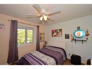Photo 43: 148 GLENEAGLES Close: Cochrane House for sale : MLS®# C4010996