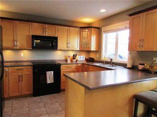 """Photo 3: 9104 118TH Avenue in Fort St. John: Fort St. John - City NE House for sale in """"KIN PARK"""" (Fort St. John (Zone 60))  : MLS®# N232074"""